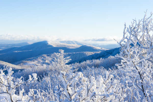 A crisp, clear winter morning reveals Blue Ridge crests caked with fresh snow and rime.
