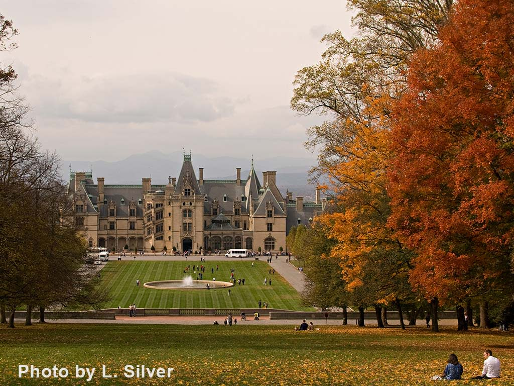 Biltmore sits between bright fall foliage and hazy, blue mountain ridges.