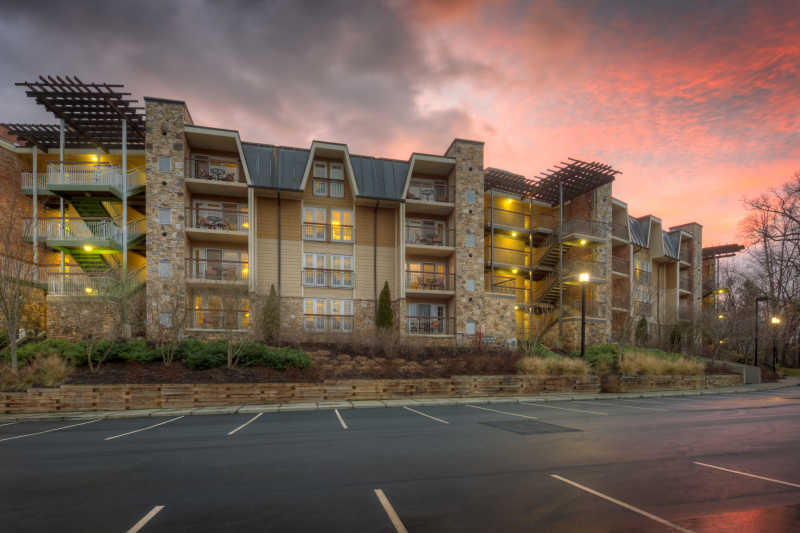 A pink summer sunset over Residences at Biltmore.