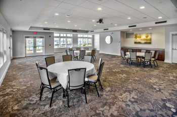 The spacious, light-filled ballroom at Lakeside Lodge Clemson features recessed lighting and contemporary carpeting.