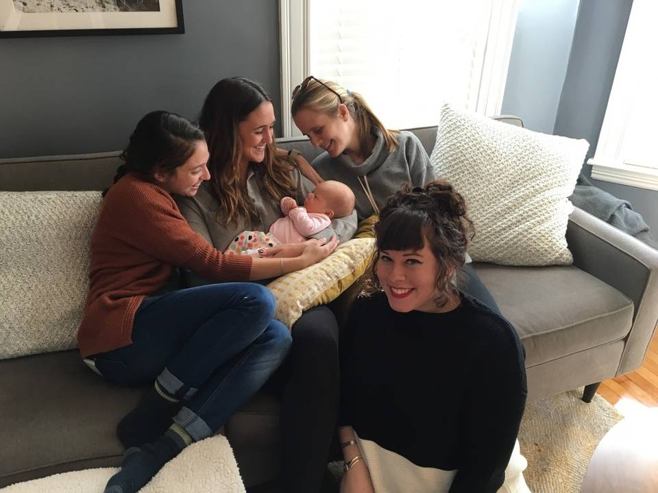 Wistians sitting on Meredith's couch with her new daughter