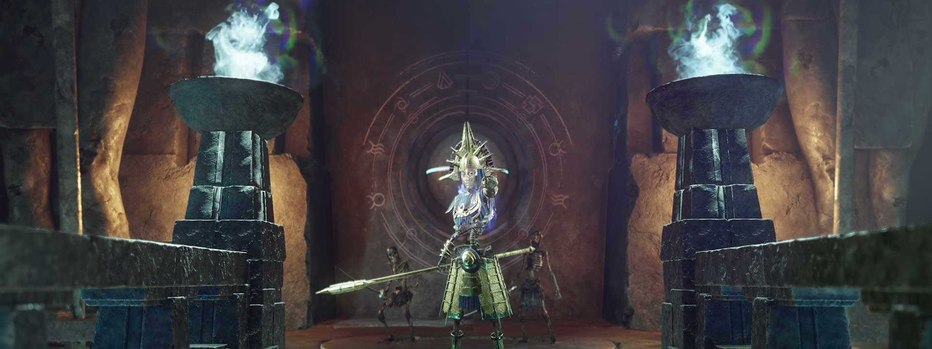 An elite Ancient enemy covered in gold ornaments holds a spear and points menacingly at the camera.