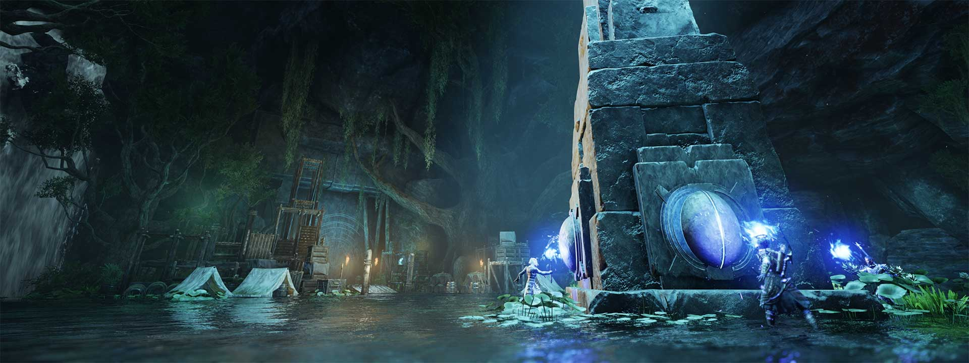 Characters holding blue-flame torches stand on each face of a towering stone obelisk inside a dark arena.