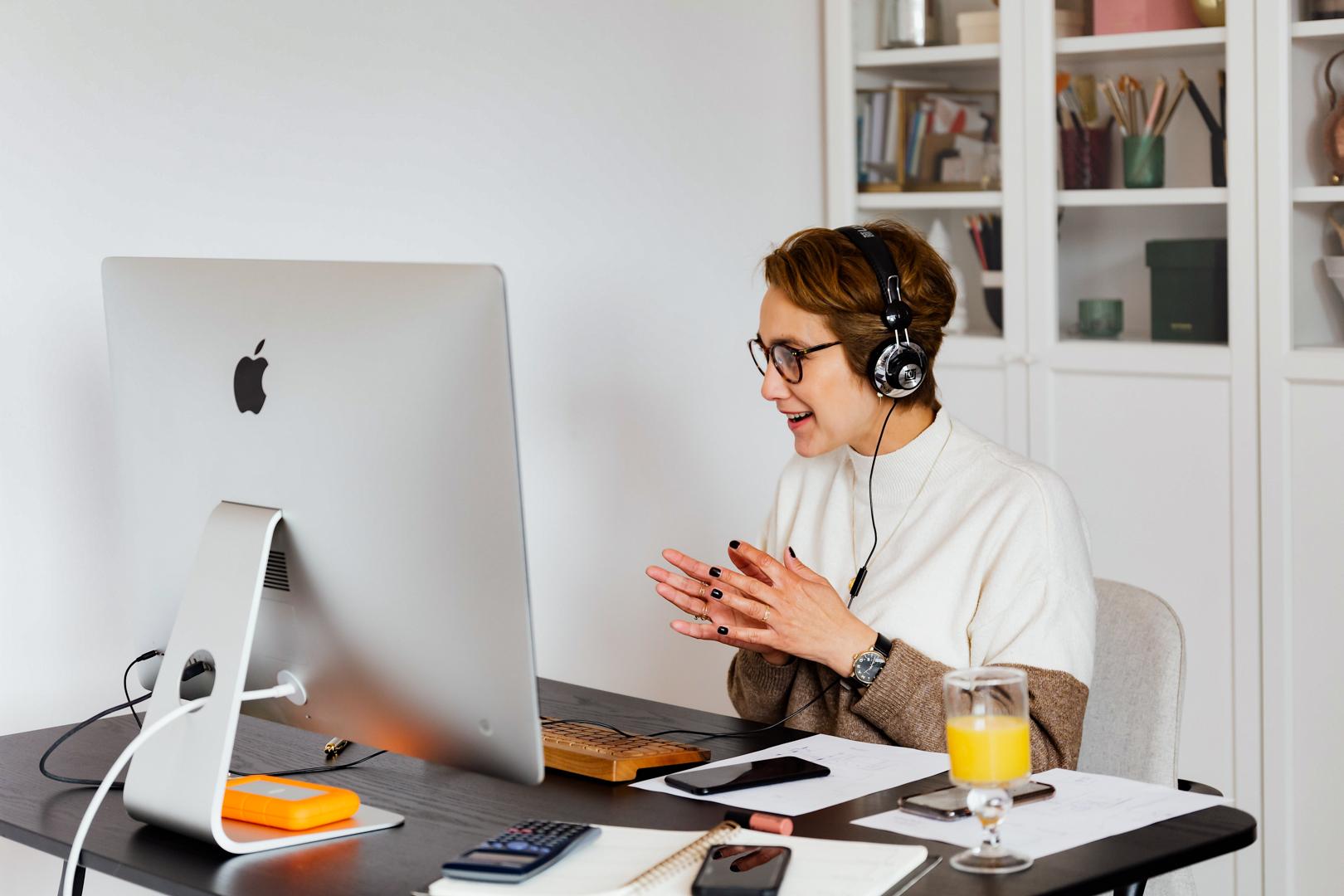 Women in front of Mac computer