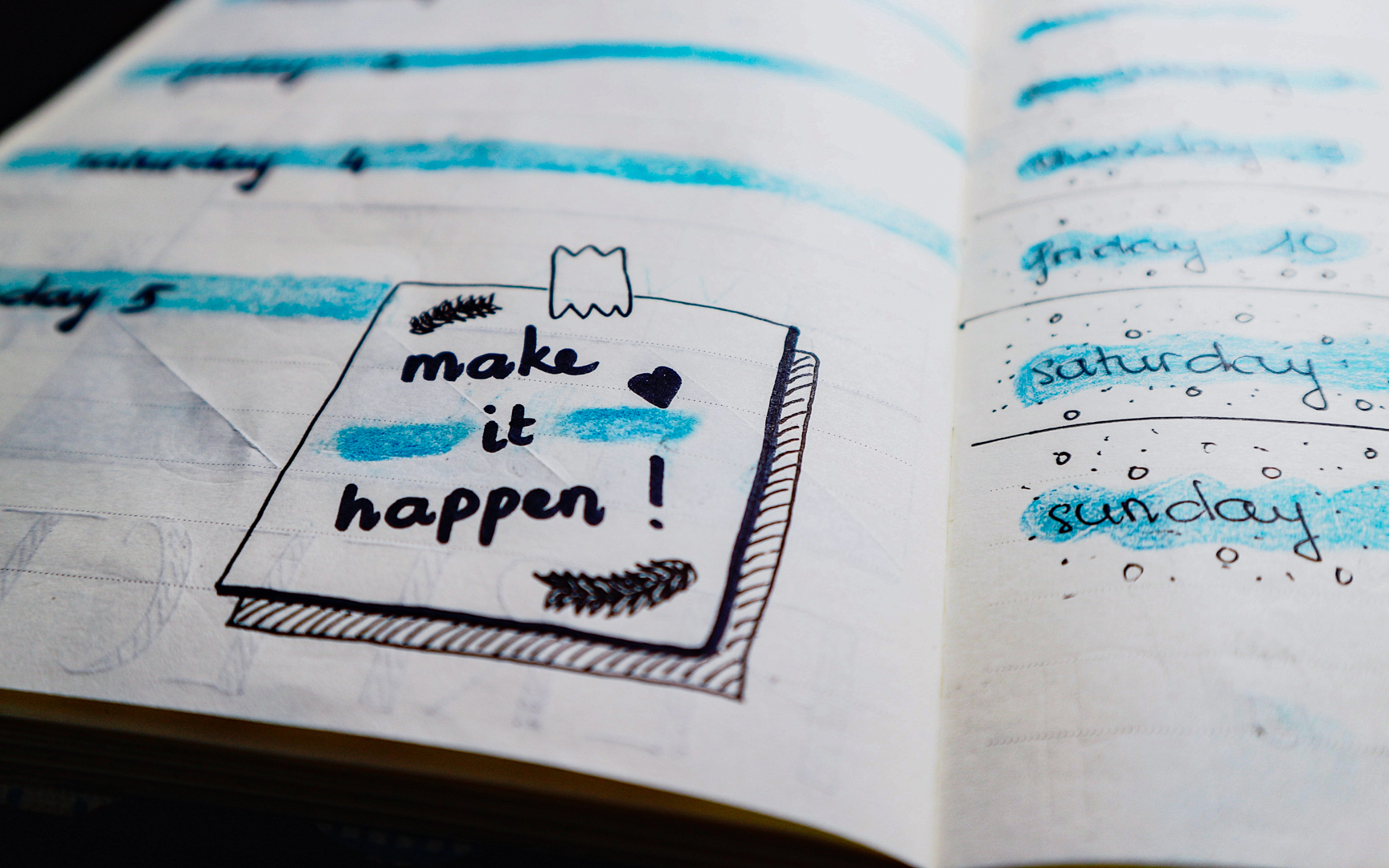 Diary with 'make it happen' text