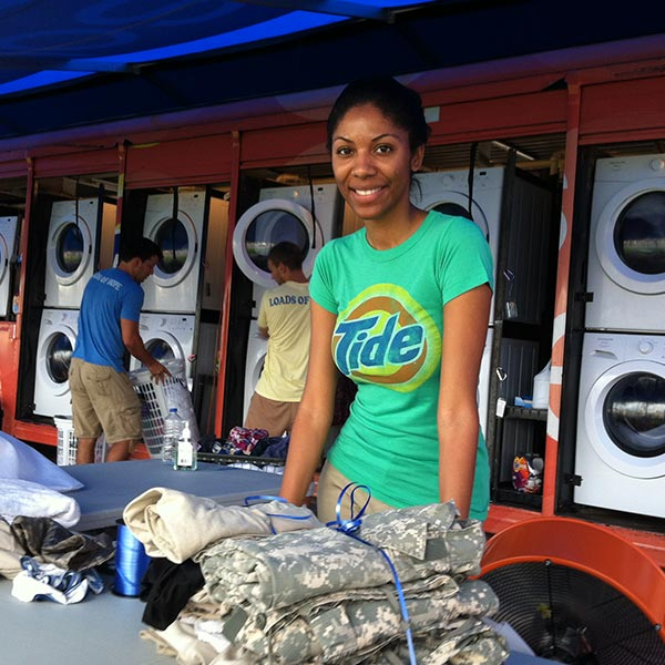 Woman in mobile laundry unit