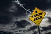 """Hurricane season"" sign with bad weather in the background"