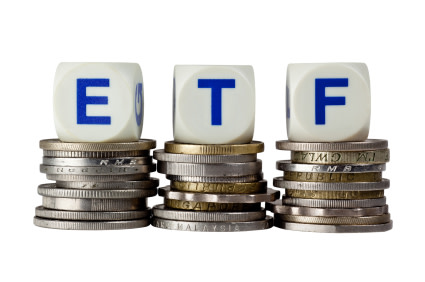 ETF Investing with ETF letters on coins.
