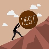 Businessman pushing debt uphill