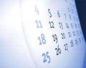 close up of white calendar with blue numbers