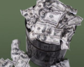 Crumpled money in a wastebasket