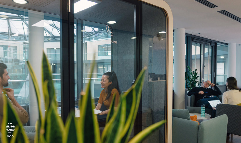 Two colleagues conducting a meeting in one of our glass booths.