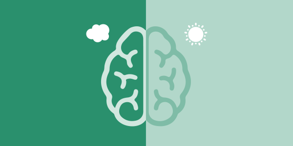 A brain. The left side is has a cloud in the corner, the right side has a sun in the corner.