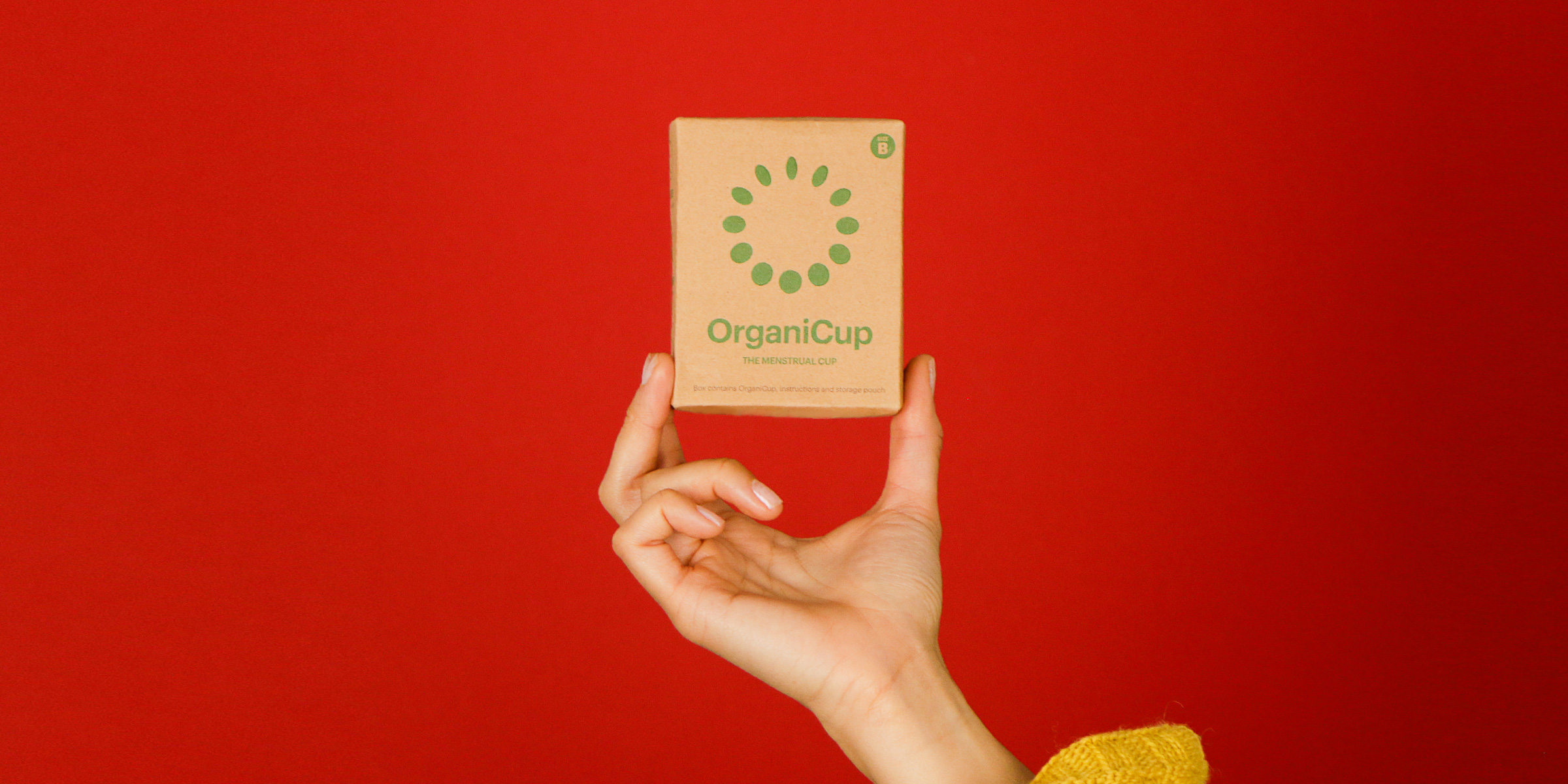 Photo of someone holding the OrganiCup packaging