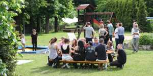 people sitting around table garden trampolin