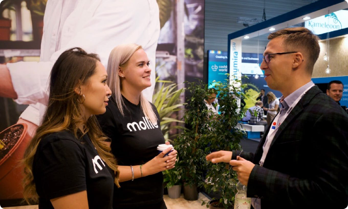Mollie employees talking to a prospect at DMEXCO 2019