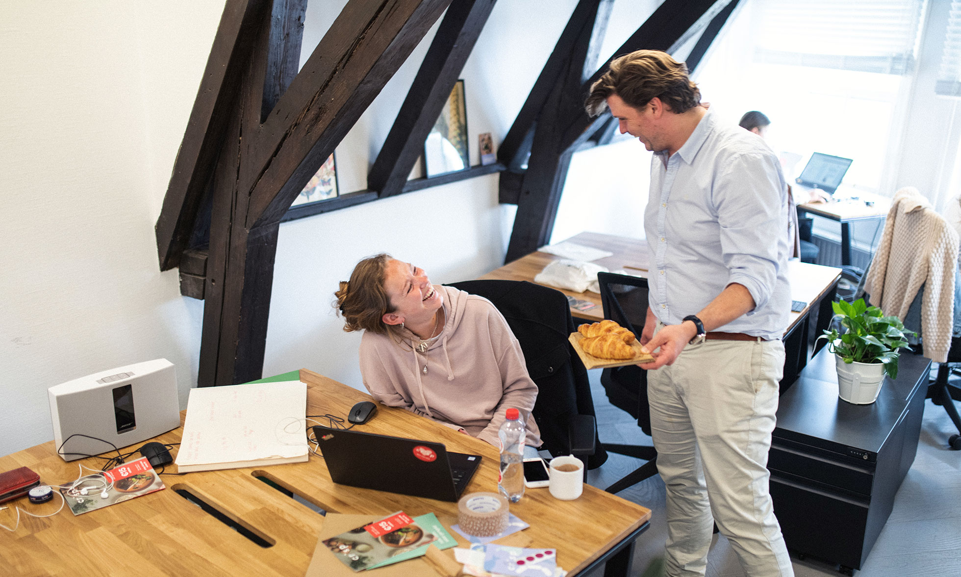 Crisp CFO Michiel Roodenburg and one of his colleagues laughing in their office