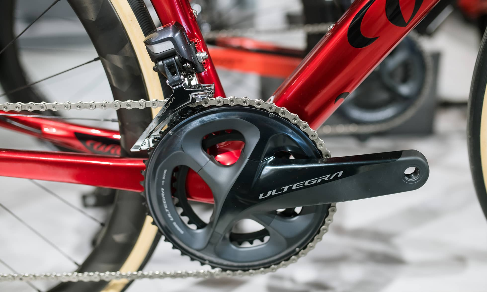Close-up of chainwheel from red racing bike