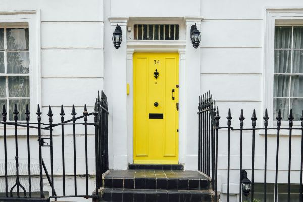house with a yellow door