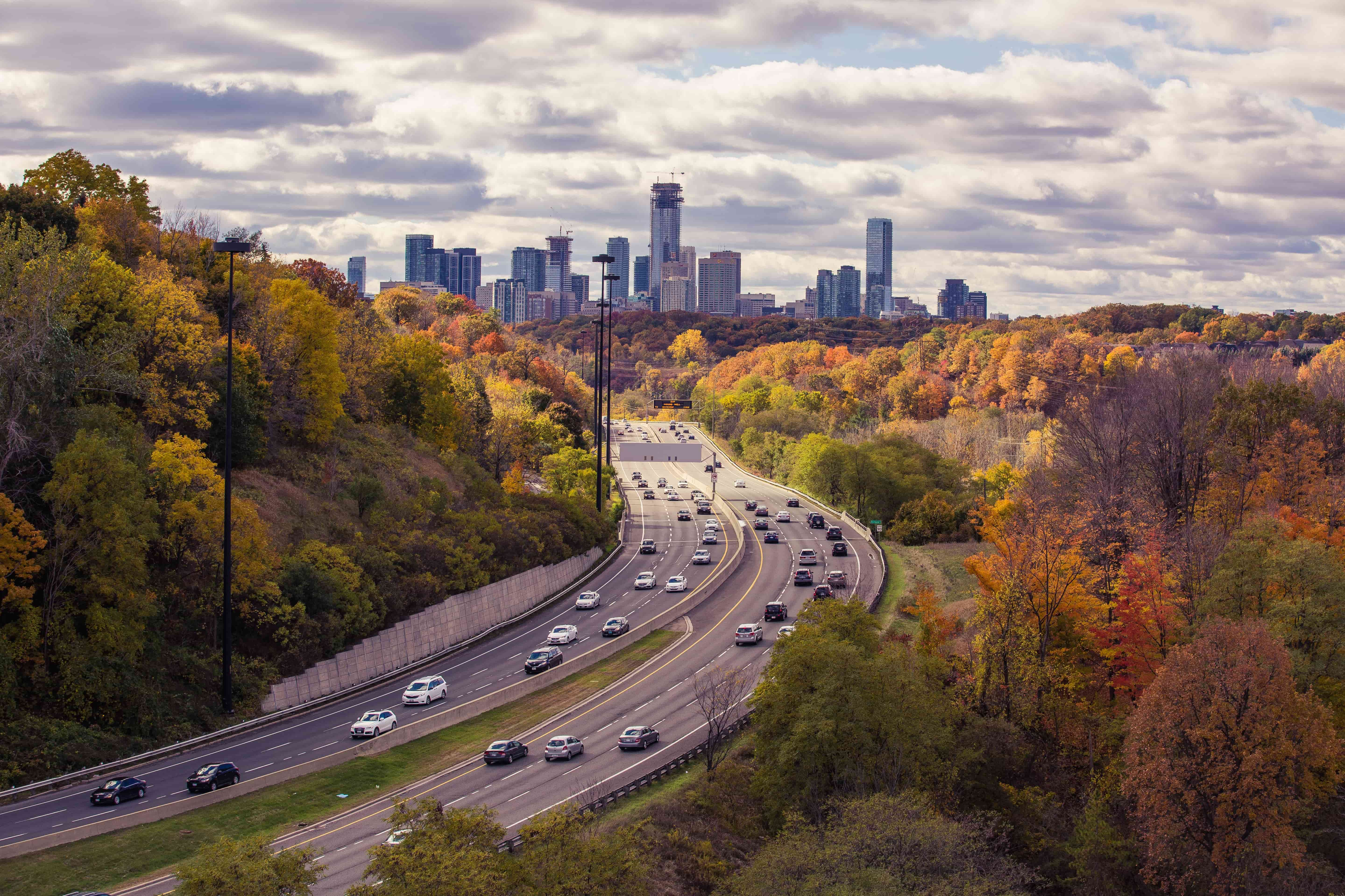 image of the Don Valley Parkway with the Toronto skyline in the distance