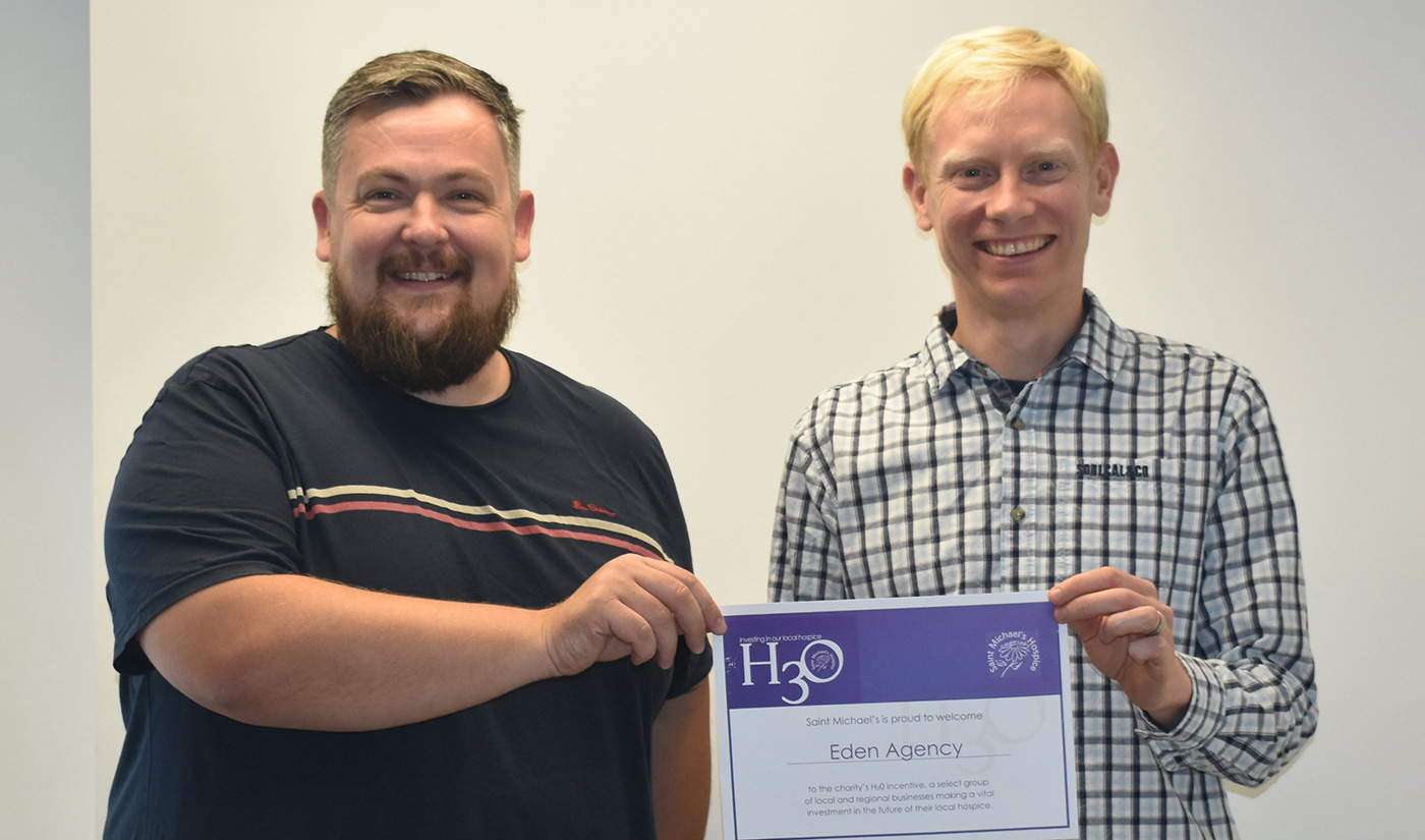 Eden directors Craig and Andy stood together holding a certificate