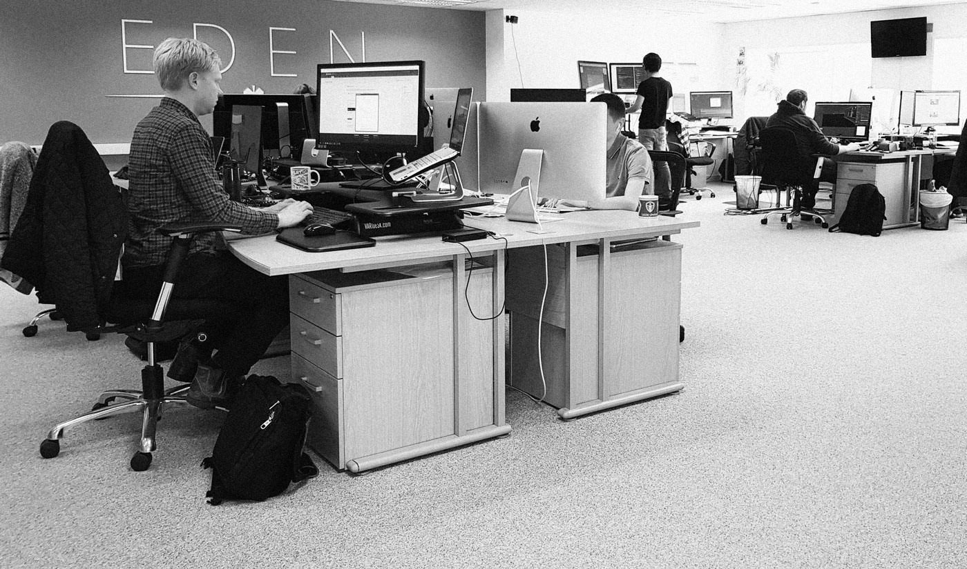 People working at their desks in the Eden Agency office