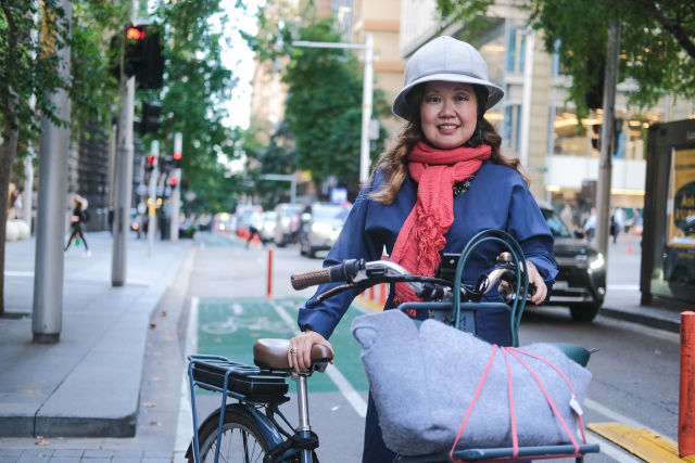 Sarah Imm has noticed more people riding bikes in regular clothes, showing a shift in bike riding culture.