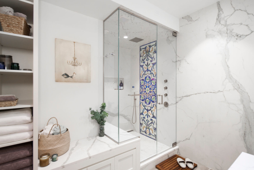 Park Slope Brownstone bathroom residential interior design renovation by Basicspace. Steam-shower bathroom with colorful mosaic art inlay, bench, built-in custom millwork and open shelving storage.