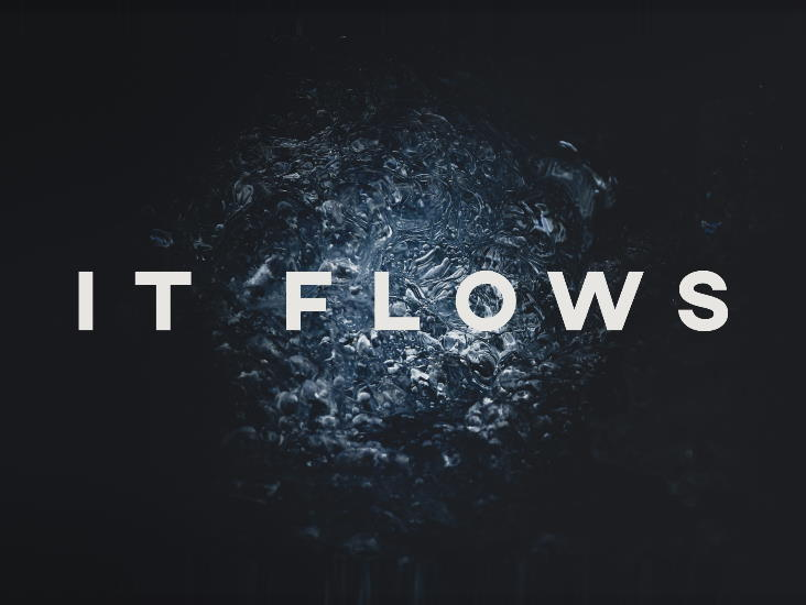 The words 'It Flows' are surrounded by dark bubbling water.