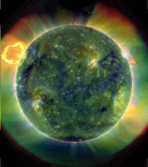 A scientific image of a solar flare showing green and yellow colors