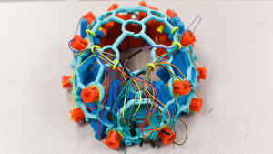 A student project of blue and orange electrodes, plastic framing and wires