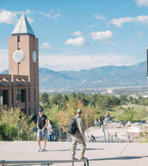 Students, many of whom include active military and veterans, walk across the UCCS campus in Colorado Springs.