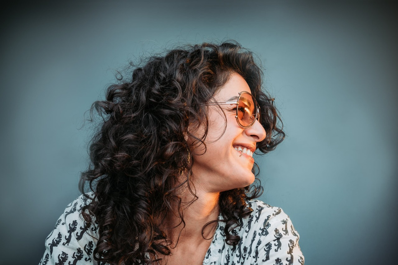 Hero Grand Vision woman laughing with orange sunglasses