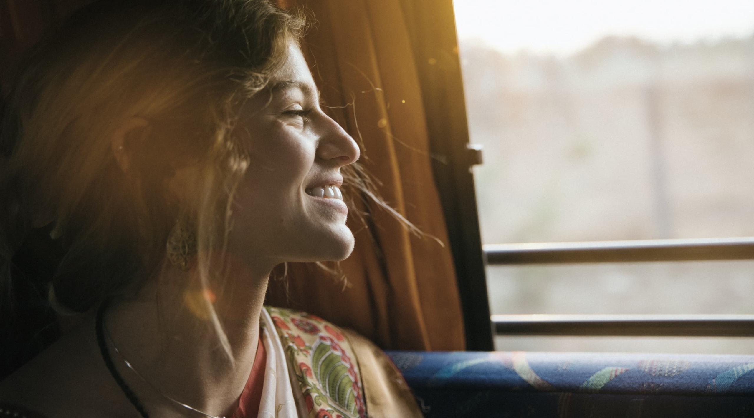 lady in bus smiling