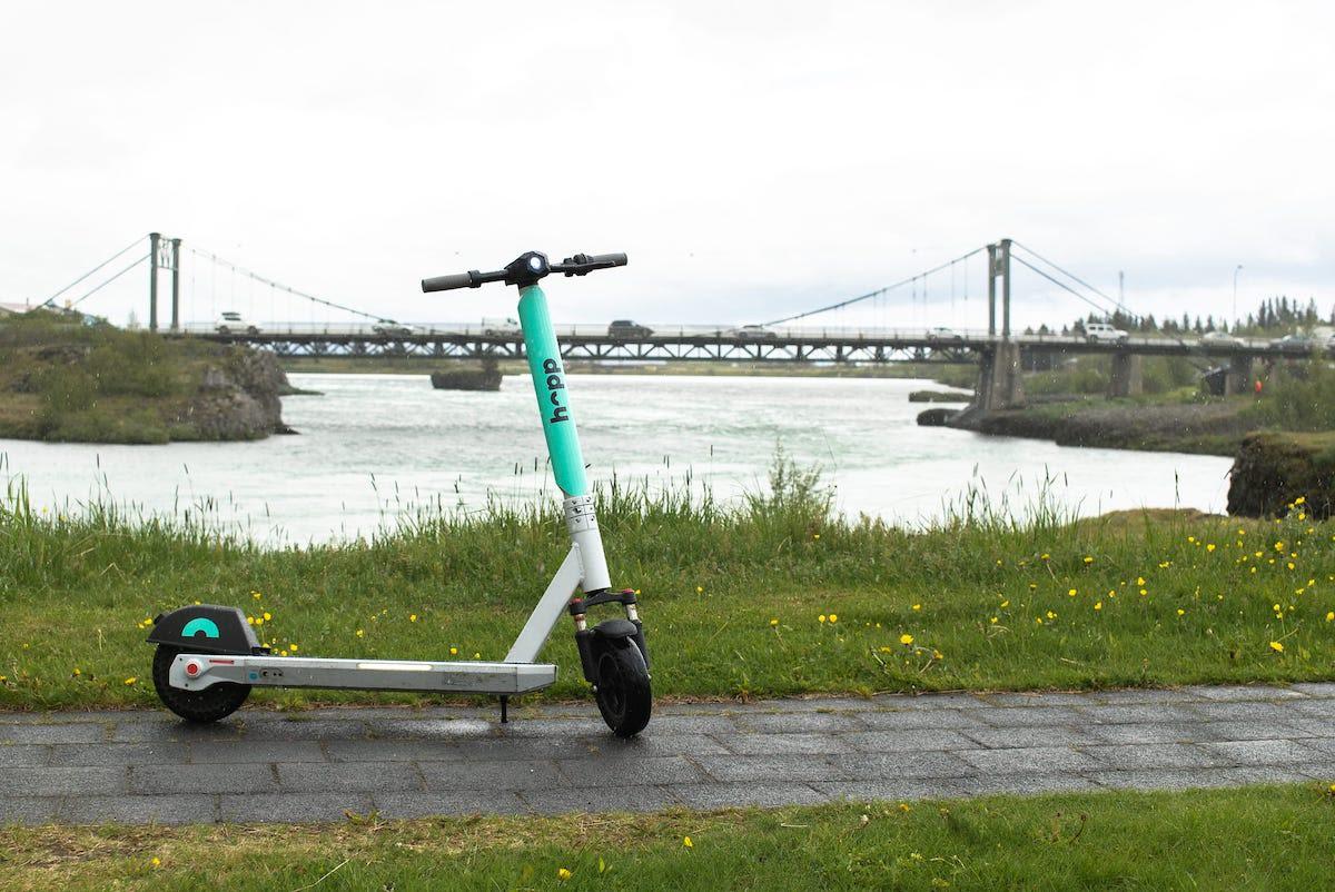 Hopp scooter in front of the Ölfus bridge over Selfoss