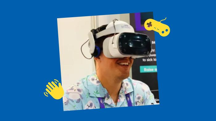 Starlight streamer, NachoPandaa wearing a Virtual Reality headset while at TwitchCon in 2019