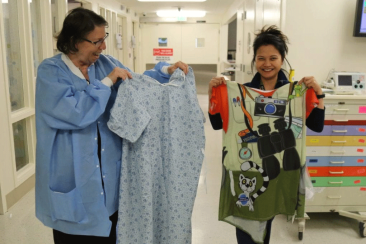 NURSES AT DIGNITY HEALTH – NORTHRIDGE HOSPITAL MEDICAL CENTER COMPARE A TYPICAL HOSPITAL GOWN TO A COLORFUL STARLIGHT GOWN.