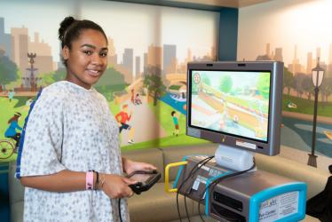 Girl in the hospital with a gaming station