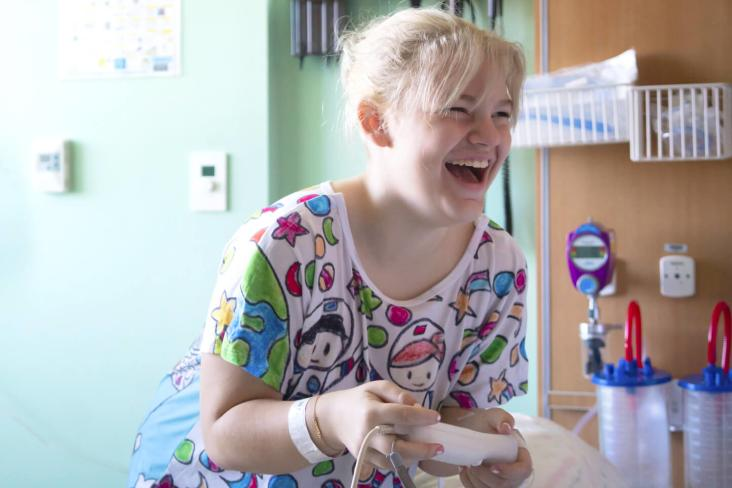Stream For Starlight image of a girl gaming in the hospital