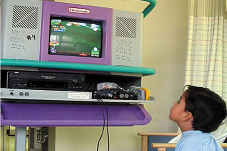 A seriously ill child enjoying video games on our Starlight Nintendo 64 console in the hospital (1998).