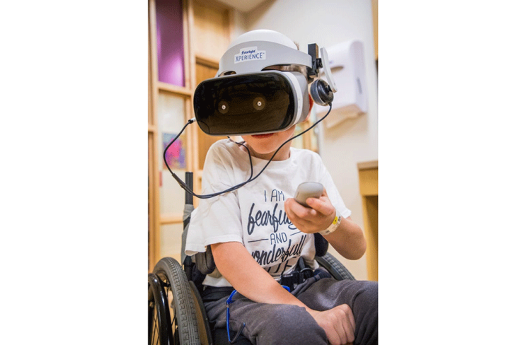 SEVEN-YEAR-OLD GRADY USING STARLIGHT VR AT GILLETTE CHILDREN'S SPECIALTY HEALTHCARE.