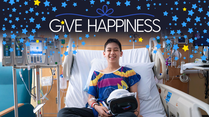 Boy in hospital bed with Starlight Virtual Reality