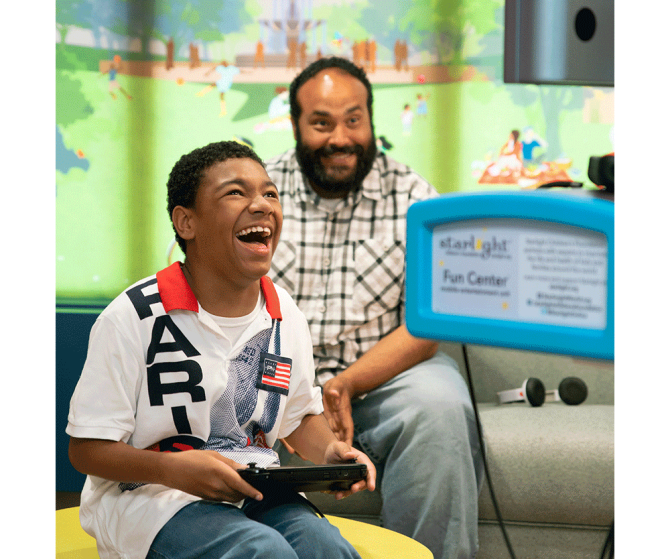 Kid and parent gaming in hospital
