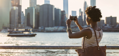 Woman taking pictures of Manhattan
