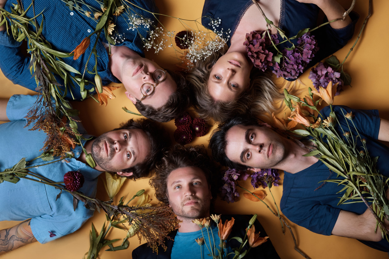 Ra Ra Riot band portrait on floor with flowers