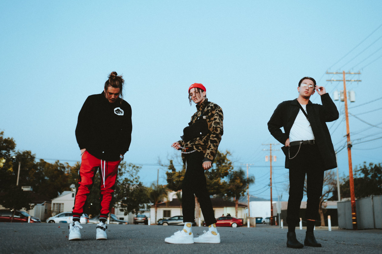 Chase Atlantic band photo outside in parking lot