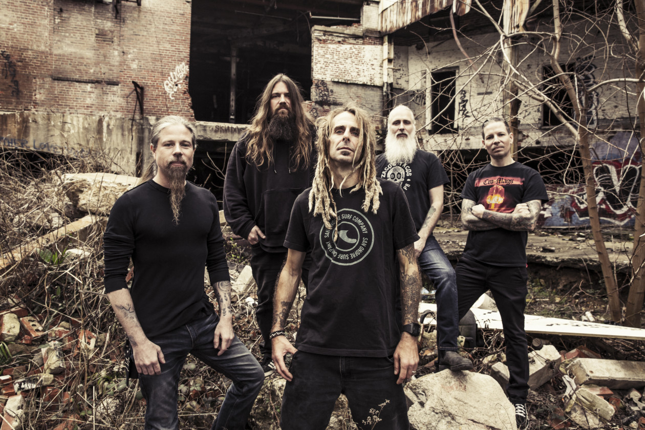 Lamb of God band photo outside in front of old building