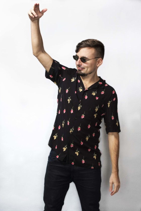 Eskuche wearing print shirt and sunglasses