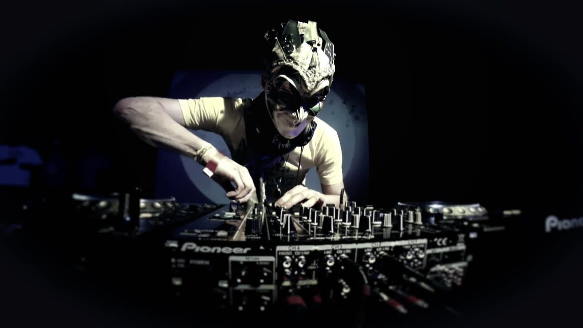 Boris Brejcha wearing mask at mixing board