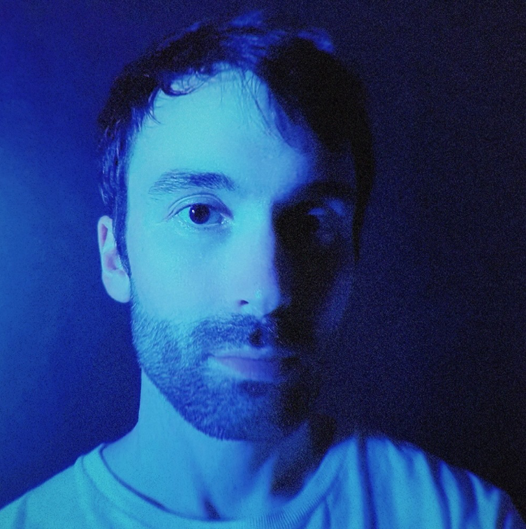 Absofacto headshot with blue filter